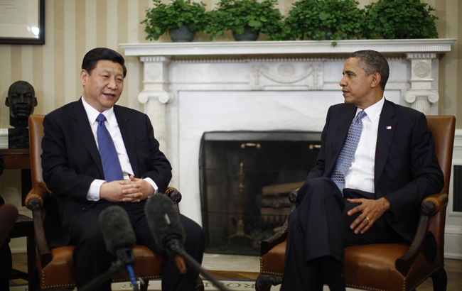 U.S. President Barack Obama (R) listens to China's Vice President Xi Jinping during their meeting in the Oval Office of the White House in Washington, February 14, 2012. Obama and Xi will hold talks on Tuesday that could help boost the international stature of China's leader-in-waiting while testing Obama's ability to balance U.S.-China diplomacy with election-year pressures. REUTERS/Jason Reed (UNITED STATES - Tags: POLITICS) - RTR2XUHB